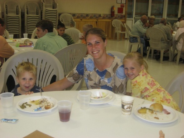 Jacob, Renita, and Chrissy Petersheim enjoying a meal