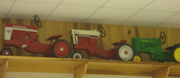 These kinds tractors line the perimeter of the wall...an impressive collection