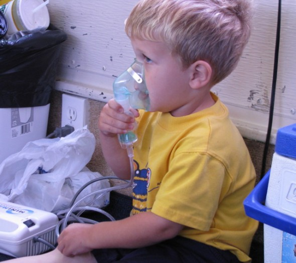 Jacob with a nebulizer for his wheezing