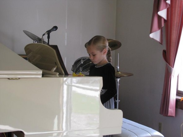 Whitney (Daryl's) is learning to play the piano, so she enjoyed practicing a little while the guys cleaned up.