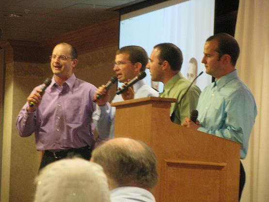 Marcus sings with his brothers and brother-in-law at Life Ministries Banquet.