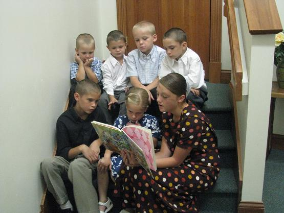 Molly (Jason's) reads to the children before the service after practicing with them for some singing