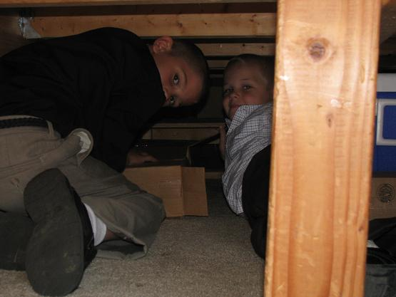 Bryce (Brian's) and Guy (Daryl's) digging out CD's from under the bus bed to restock the CD stand.