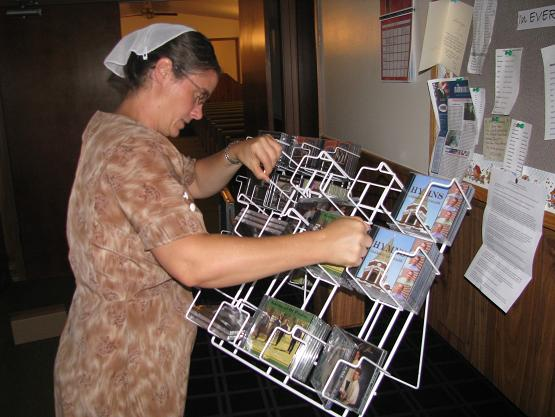 Sheryl setting up the CD rack.