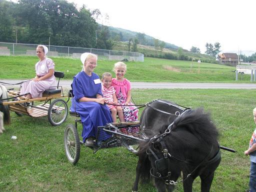 Pony-cart rides --Chrissy Petersheim and Brooklyn Fox